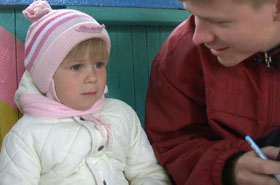Mark interviews a Russian girl as part of his research.