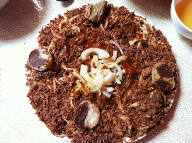 Traditional Beshbamark Issyk Kul (long noodles with crumbled horsemeat, topped with horse meat slices and intestine rings )